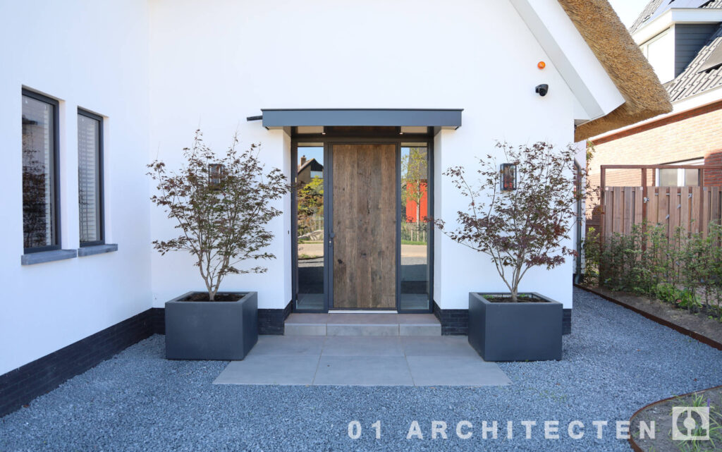 architectenbureau enschede villa gevelisolatie luifel entree symmetrie gelijke opzet